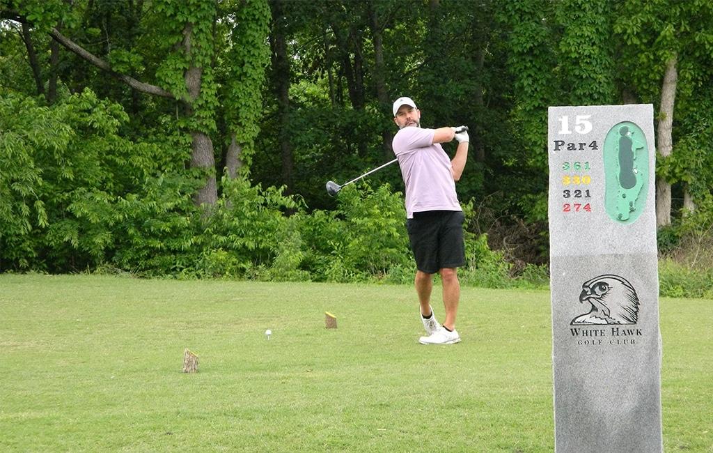 Man taking a shot while playing golf